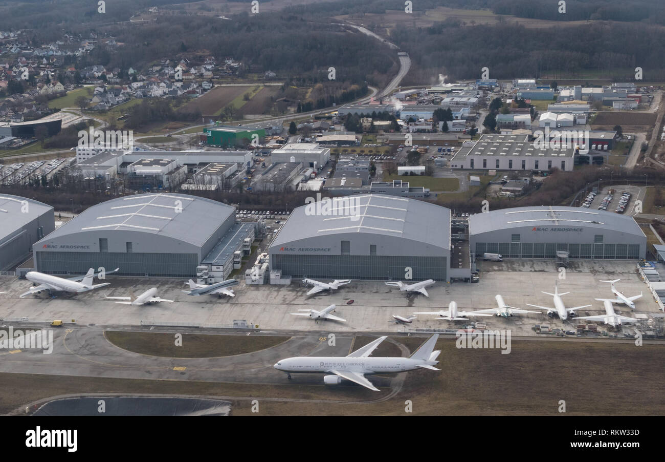 AMAC Aerospace at EuroAirport Basel Mulhouse Freiburg, Saint-Louis, France,  including the Gabon Presidential Boeing 777-200 in the foreground - Stock Image