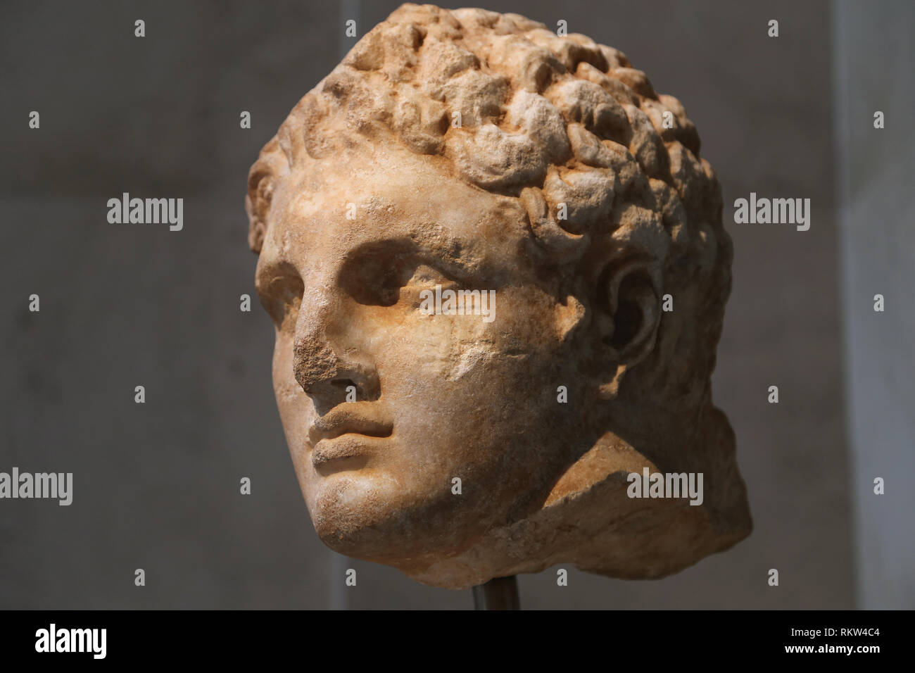 Marble head of a youth from a relief. Greek, late 4th BCE. From Rhores. The Met, Ny, USA - Stock Image