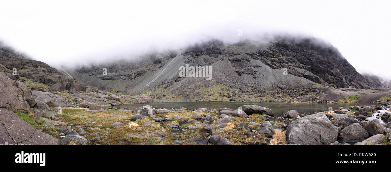 Panoramic image of Coire Lagan lochan high in the Black Cuillin mountains on the isle of Skye, Scotland, UK - Stock Image