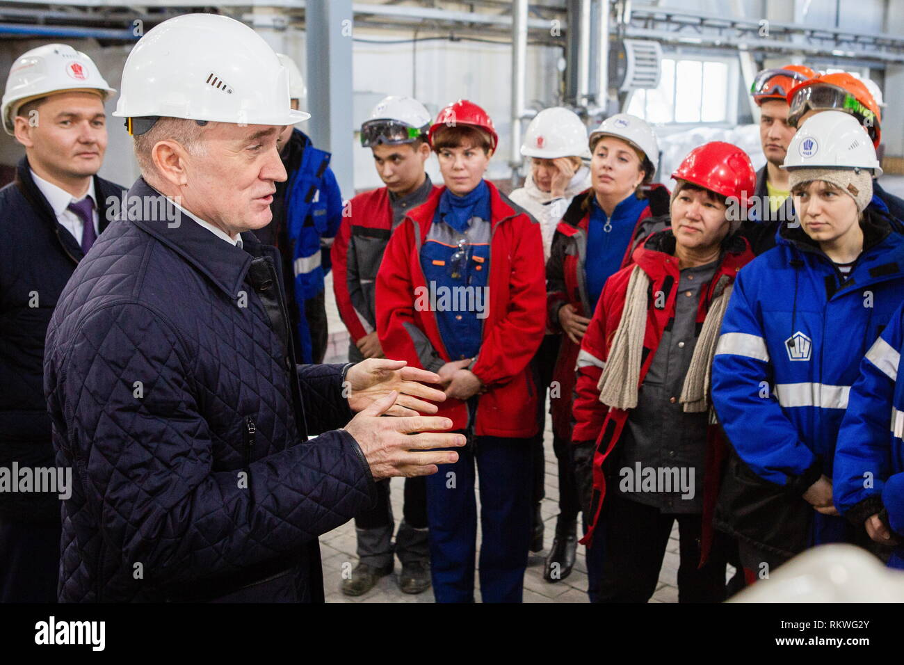 Chelyabinsk, Russia. 12th Feb, 2019. CHELYABINSK, RUSSIA - FEBRUARY 12, 2019: Pavel Izbrekht, general director, chairman of the Management Board at Chelyabinsk Zinc Plant, and Chelyabinsk Region Governor Boris Dubrovsky (L-R) talk to Chelyabinsk Zinc Plant workers. Nail Fattakhov/TASS Credit: ITAR-TASS News Agency/Alamy Live News - Stock Image