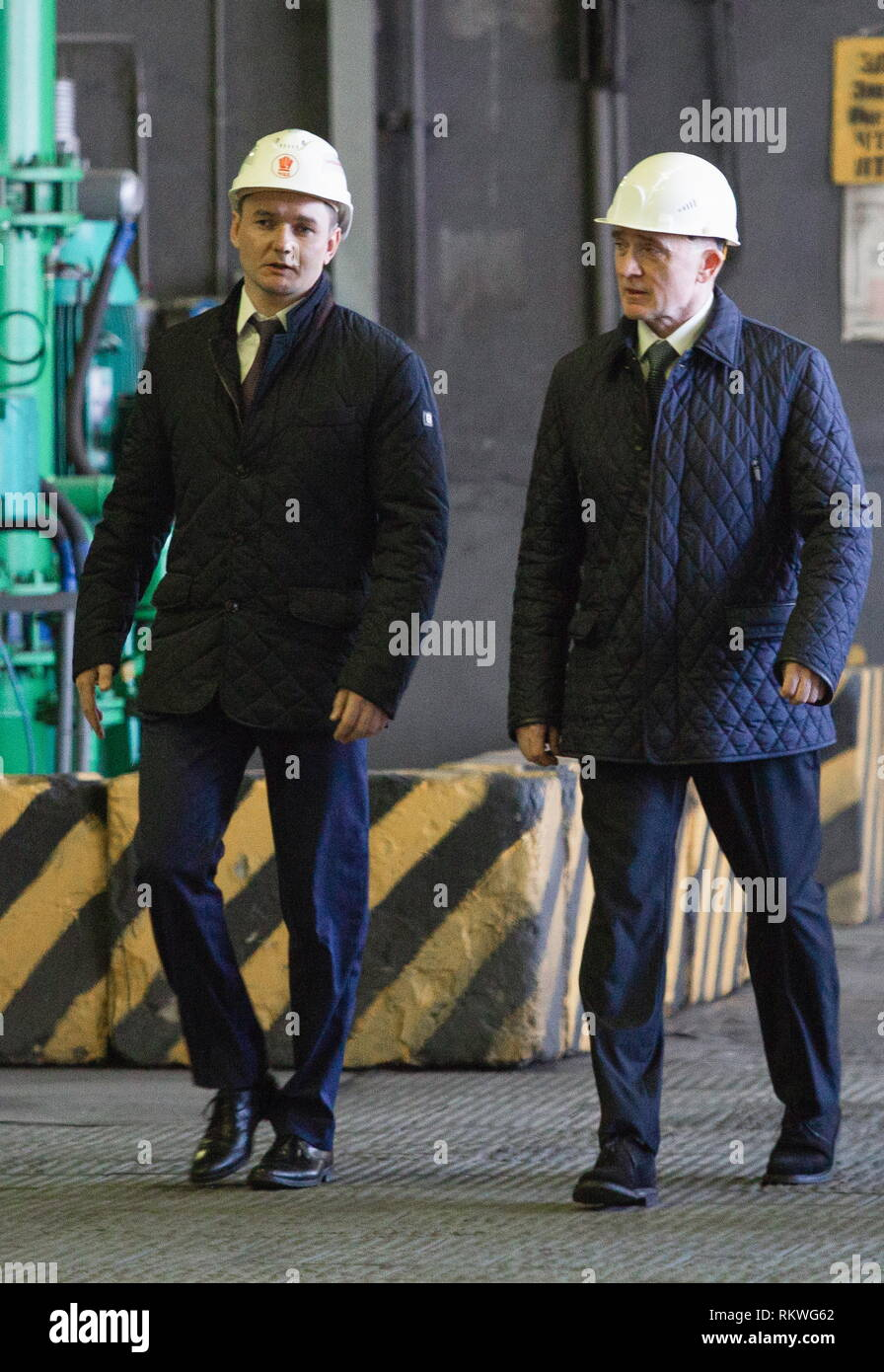 Chelyabinsk, Russia. 12th Feb, 2019. CHELYABINSK, RUSSIA - FEBRUARY 12, 2019: Pavel Izbrekht (L), general director, chairman of the Management Board at Chelyabinsk Zinc Plant, and Chelyabinsk Region Governor Boris Dubrovsky at the Chelyabinsk Zinc Plant. Nail Fattakhov/TASS Credit: ITAR-TASS News Agency/Alamy Live News - Stock Image