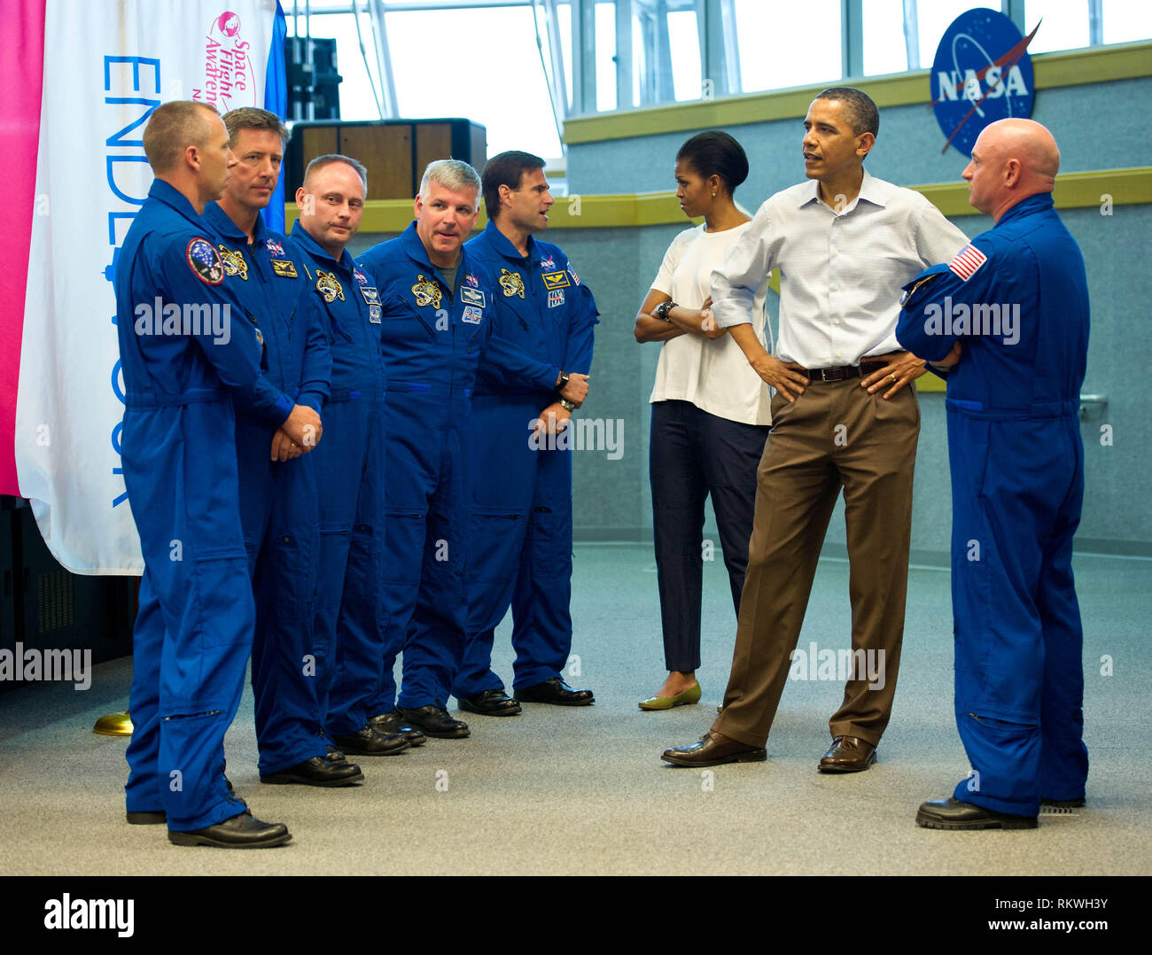 United States President Barack Obama and First Lady Michelle Obama meet with STS-134 space shuttle Endeavor commander Mark Kelly, right, and shuttle astronauts, from left, Andrew Feustel, European Space Agency's Roberto Vittori, Michael Fincke, Gregory H. Johnson, and Greg Chamitoff, after their launch was scrubbed, Friday, April 29, 2011, at Kennedy Space Center in Cape Canaveral, Florida.Mandatory Credit: Bill Ingalls/NASA via CNP | usage worldwide - Stock Image
