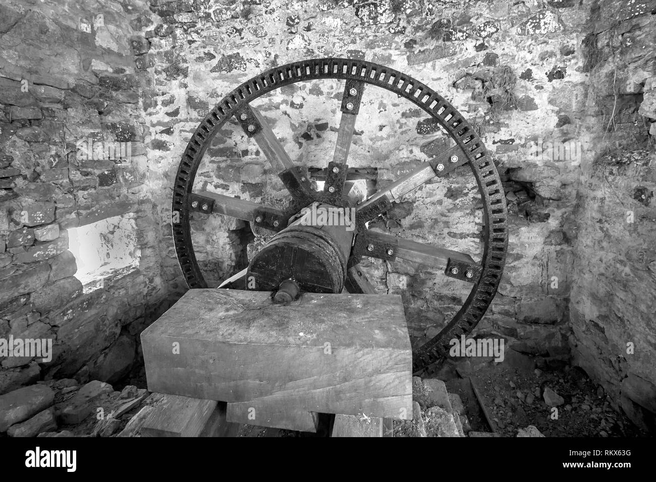 An infrared monochrome image of the internal gearwheel of the Flour and grain Mill on Alderney, Channel Islands. - Stock Image