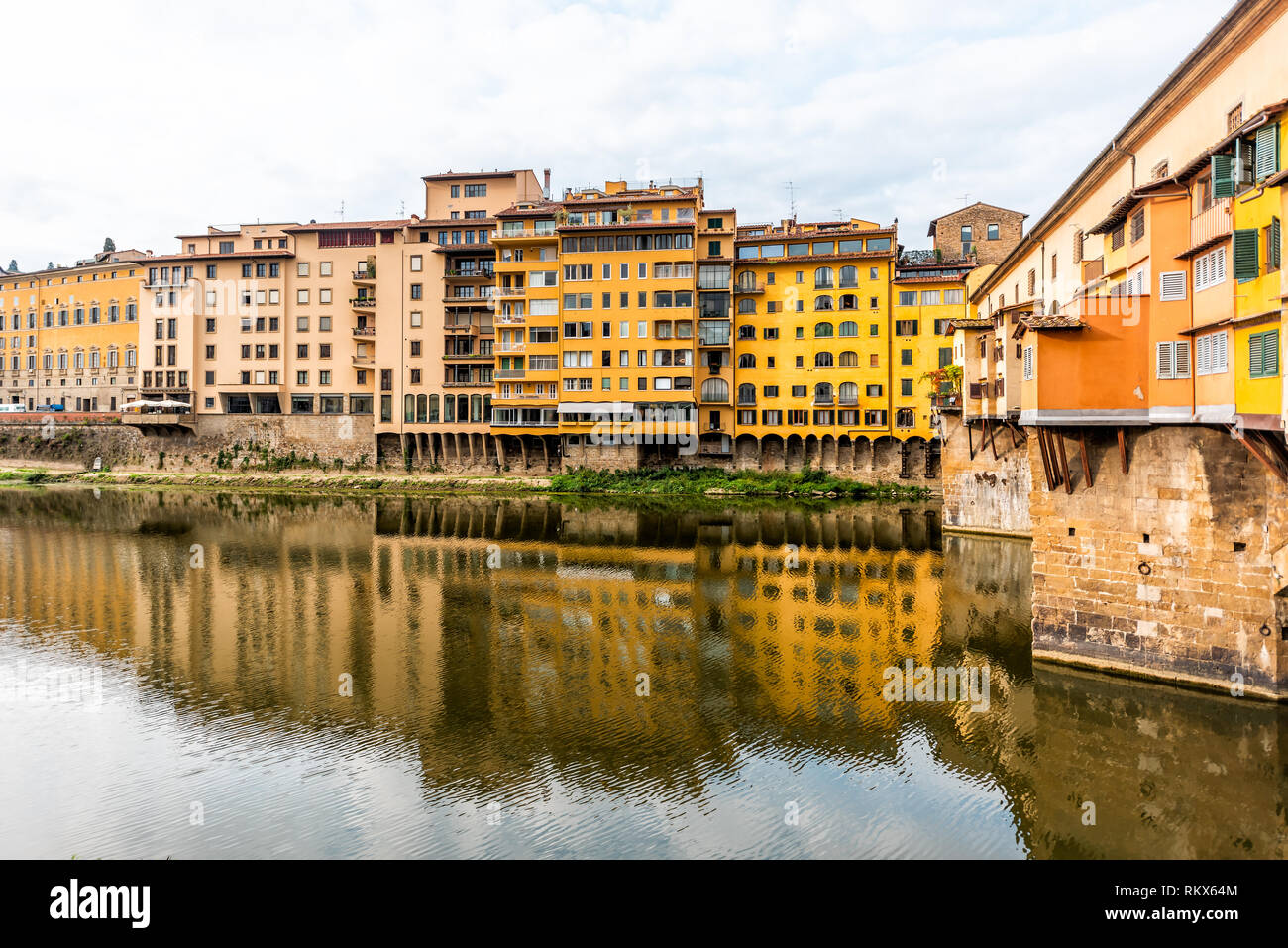 Florence, Italy Firenze orange yellow colorful building on Ponte Vecchio by Arno river during summer morning in Tuscany with nobody vibrant - Stock Image