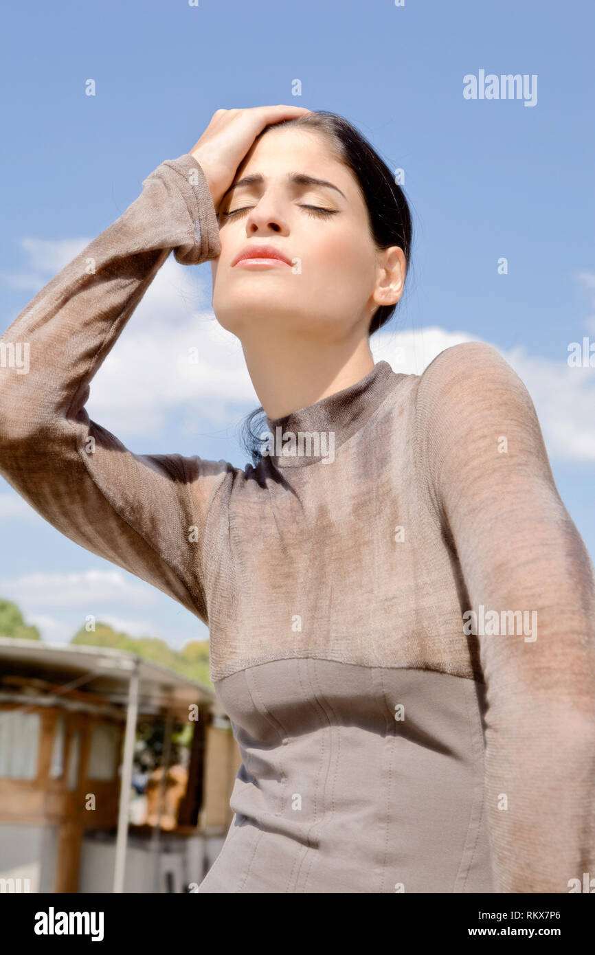 Fashion model posing outdoors. France - Stock Image