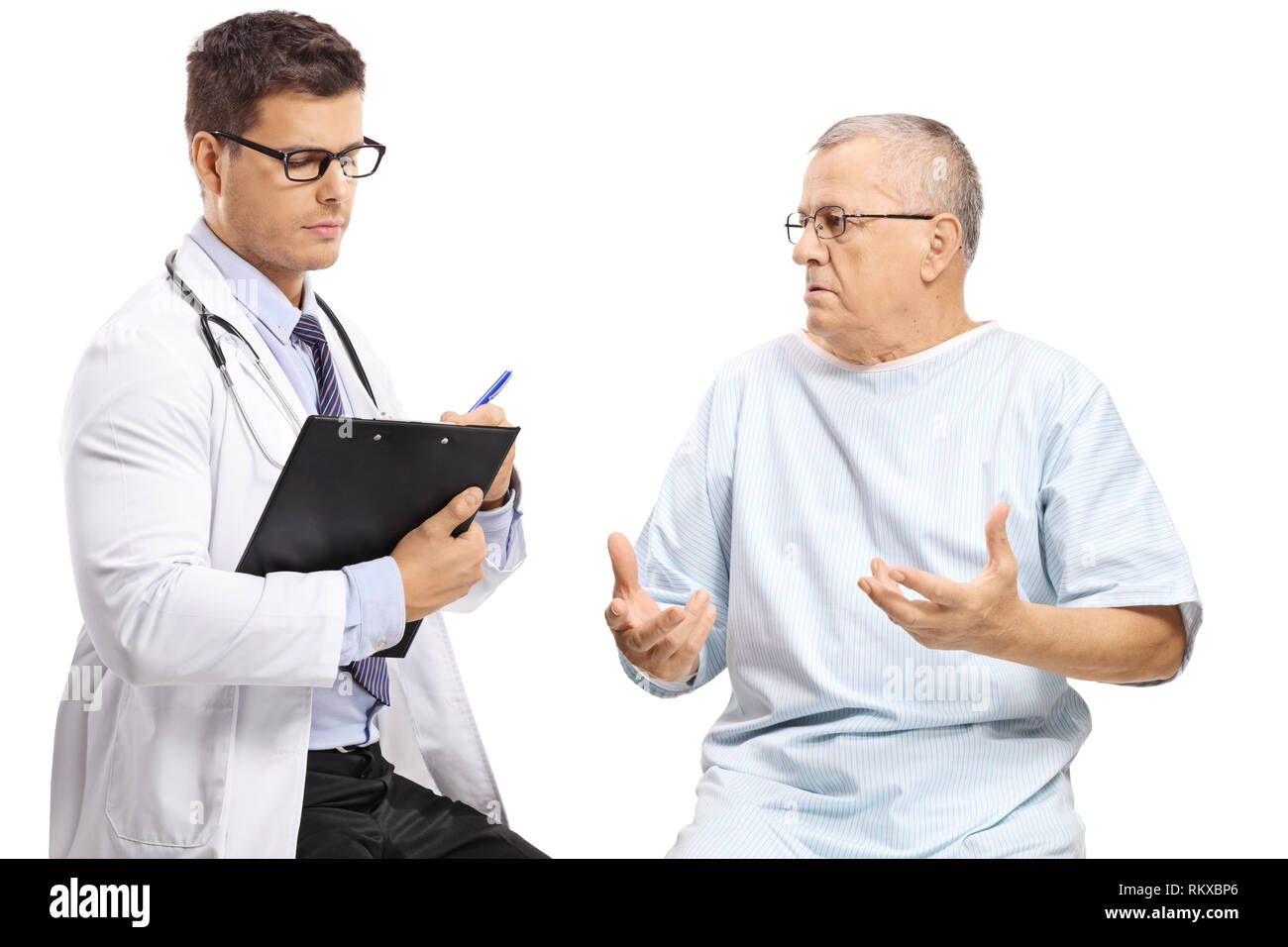 Mature male patient talking to a doctor writing isolated on white background - Stock Image