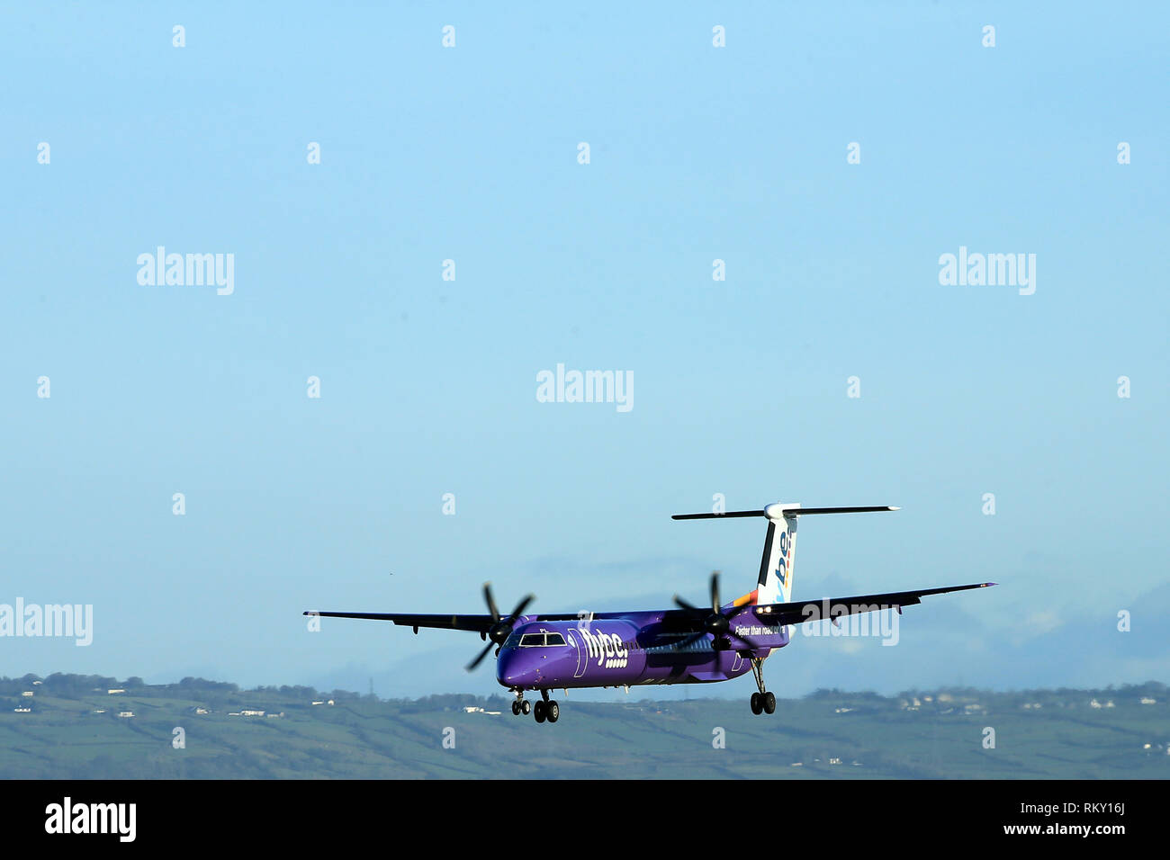 Aircraft arrive and depart from George Best Belfast City Airport in Belfast, Northern Ireland. - Stock Image