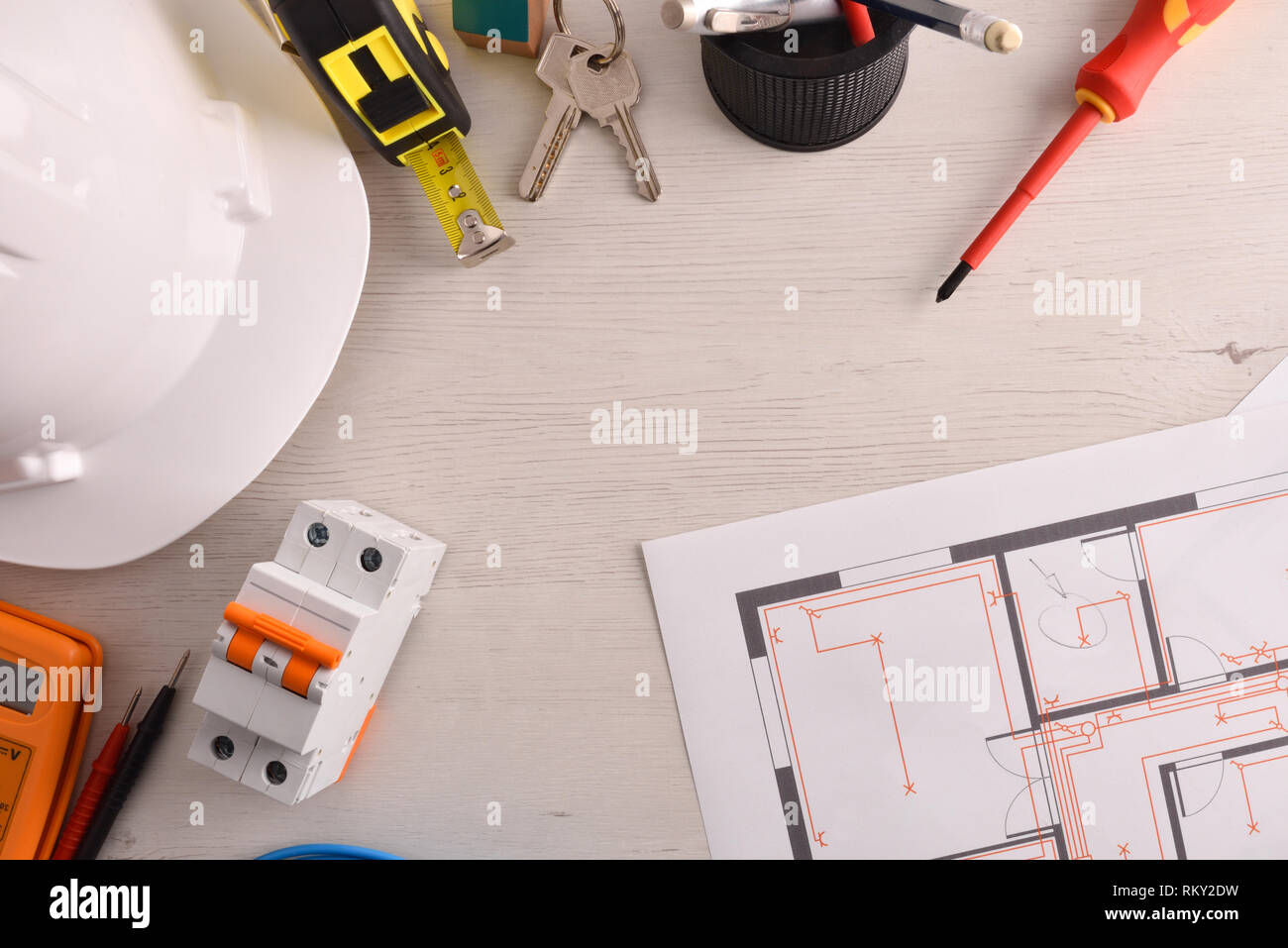 office table of electrical engineer with installation project and Electrical Plans Drawings
