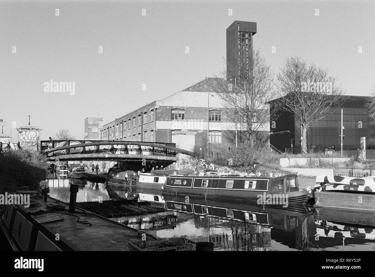 The River Lea Navigation at Hackney Wick, East London UK, with narrowboats - Stock Image