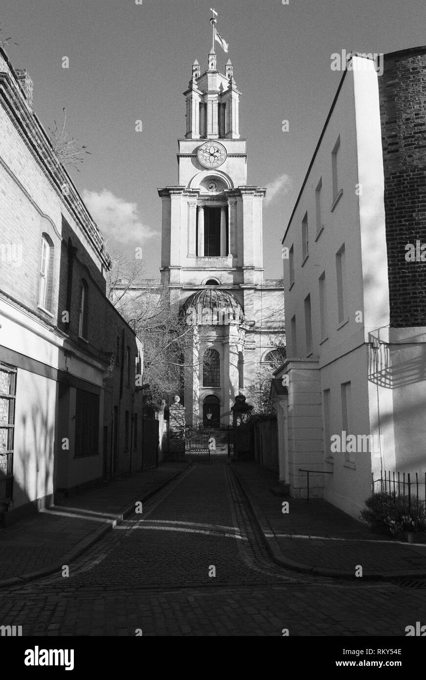 St Anne's church tower, Limehouse, East London, from Newell Street, looking down St Anne's Passage - Stock Image