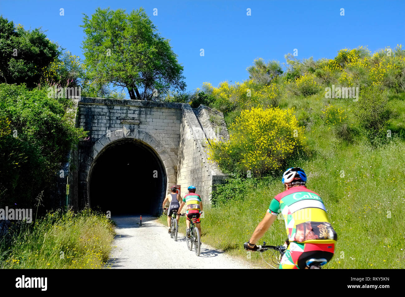 Cyclists enjoying cycling along the Via Verde, a disused oil railway line in the Sierra Subbetica, Andalucia, Spain - Stock Image