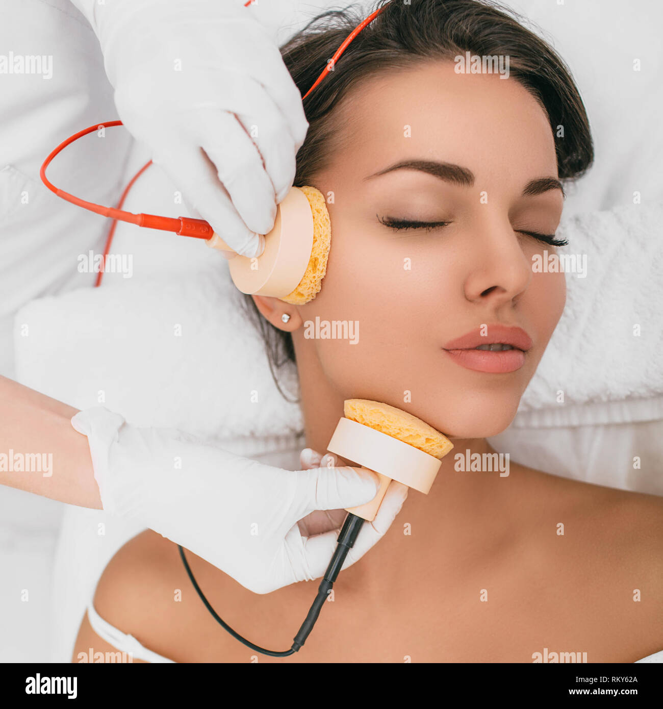 Beautiful woman receiving body microcurrent procedure for facelift Stock Photo