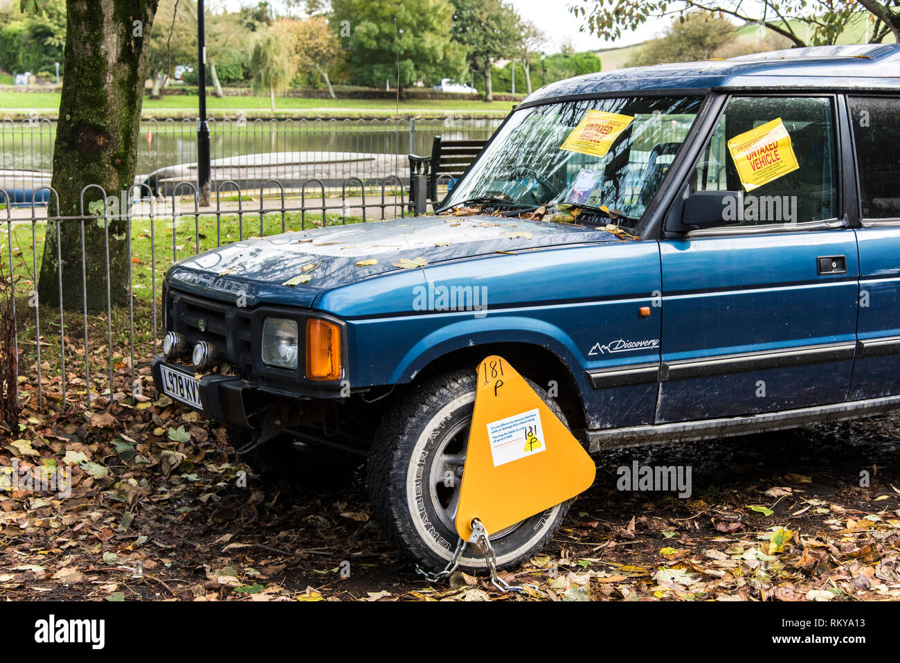 An untaxed Land Rover Discovery 4x4 vehicle clamped and ticketed. Stock Photo