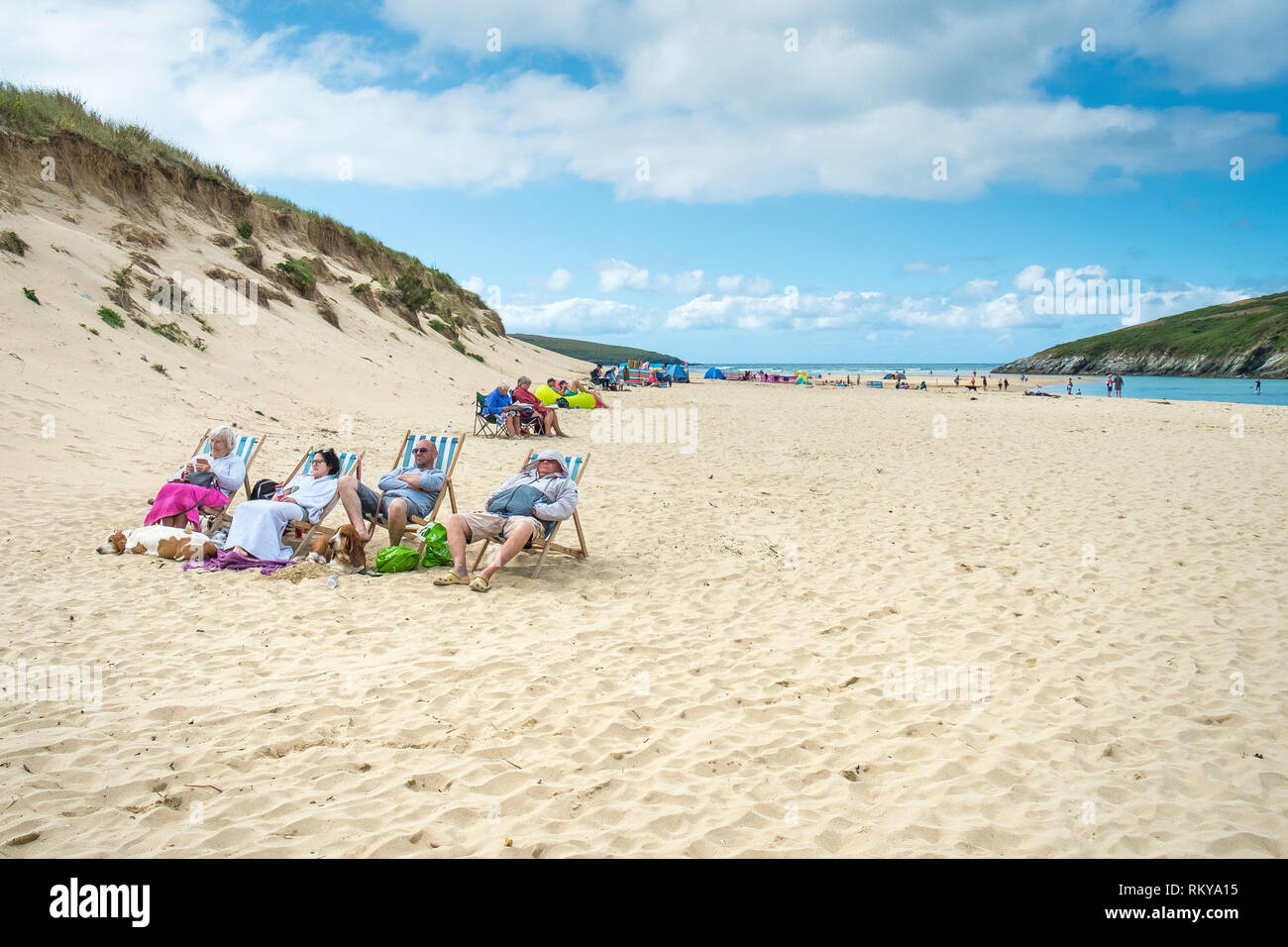 Holidaymakers on Crantock Beach in Newquay in Cornwall. - Stock Image