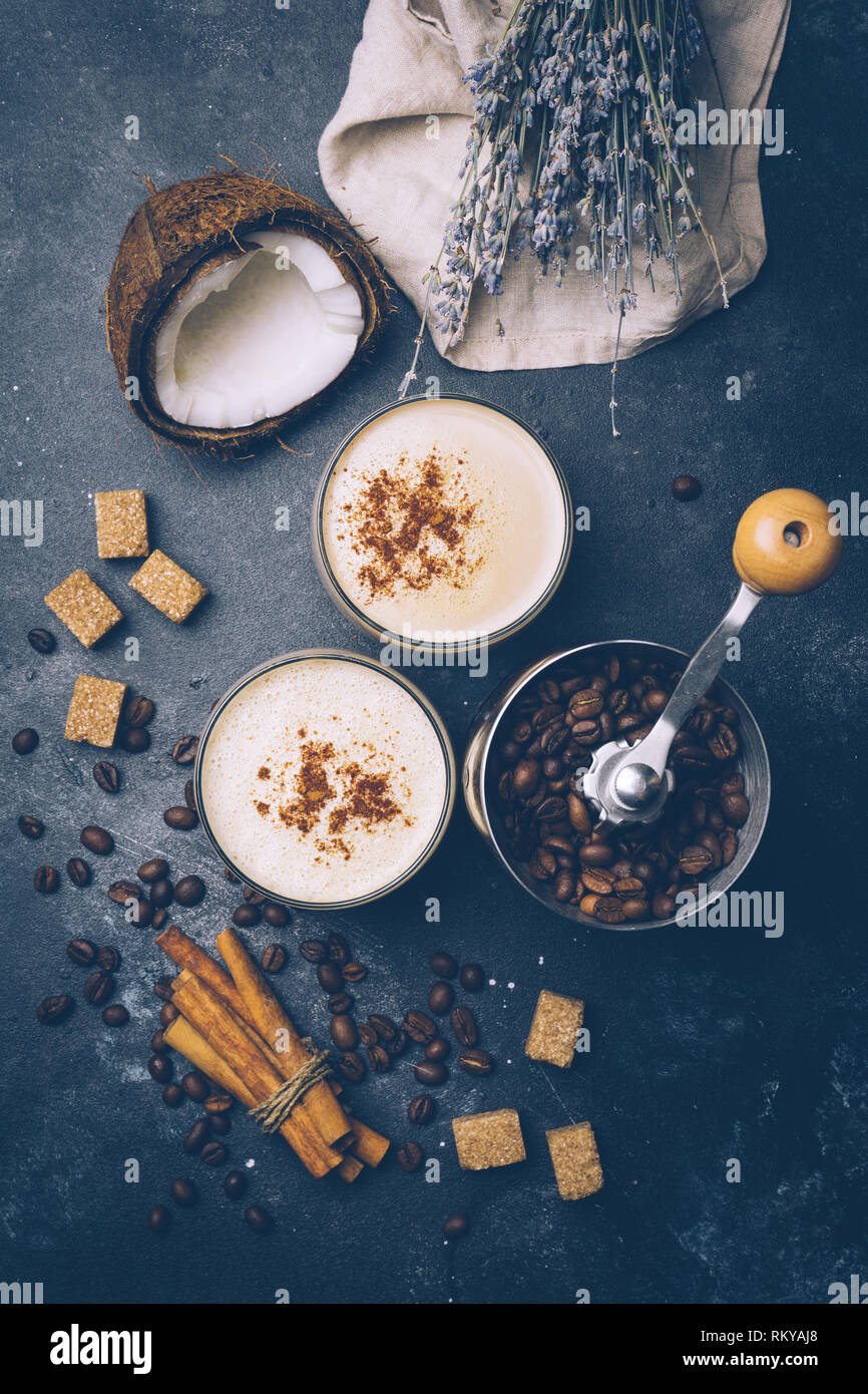 Coconut latte. Vegan coffee drink concept. Coffee with coconut milk. Health products Stock Photo