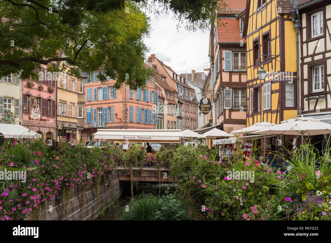 Colmar Old Town buildings and street cafes in summer, Colmar, Alsace, France, Europe - Stock Image