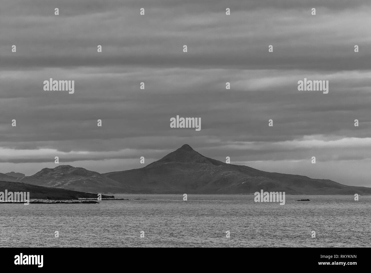 Scenic cruising around the remote legendary Cape Horn. This is where the Pacific and Atlantic oceans meet and notorious for its treacherous waters. - Stock Image