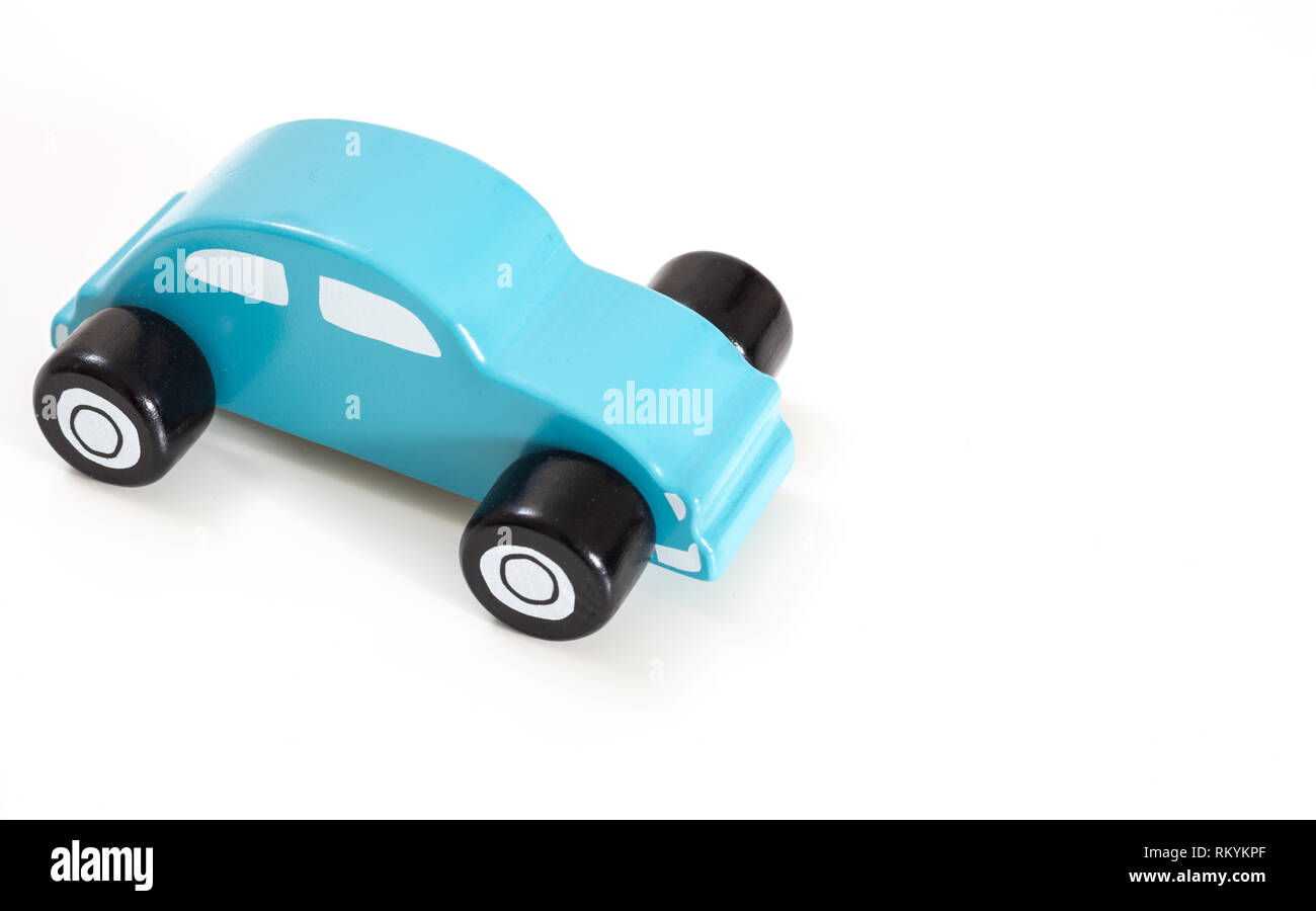 A blue toy car, on white background with copy-space. Stock Photo