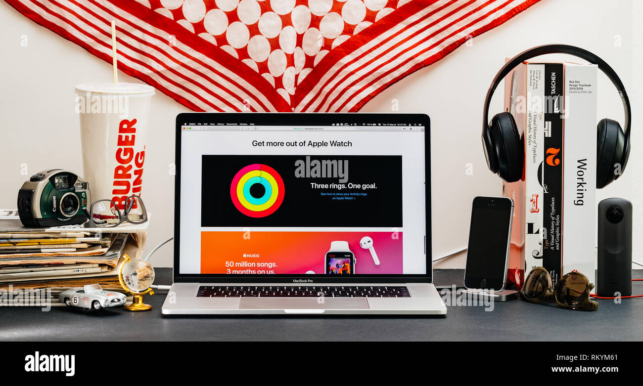 LONDON, UK - SEP 13, 2018: Creative room table with Safari Browser on MacBook Pro laptop showcasing Apple Computers website latest Apple Watch series 4 with get more oout of the watch - Stock Image