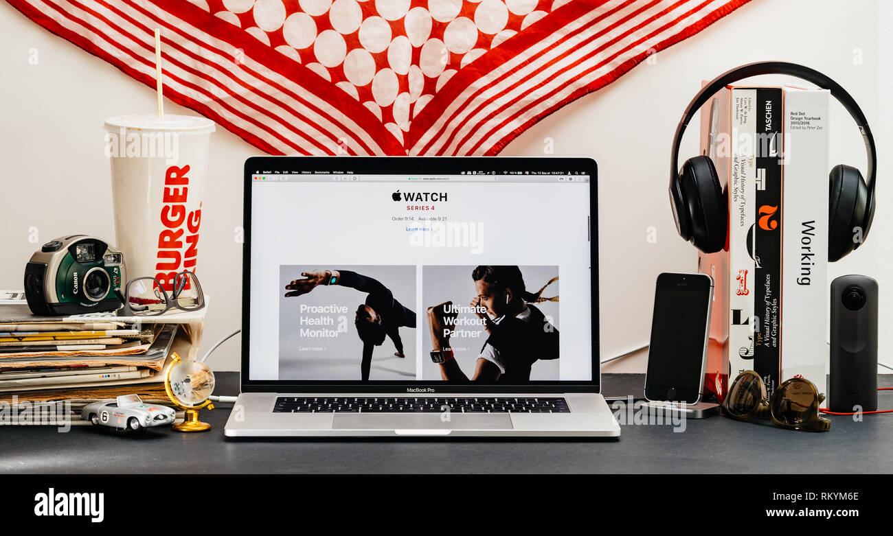 LONDON, UK - SEP 13, 2018: Creative room table with Safari Browser on MacBook Pro laptop showcasing Apple Computers website latest Apple Watch series 4 proactive health monitor - Stock Image