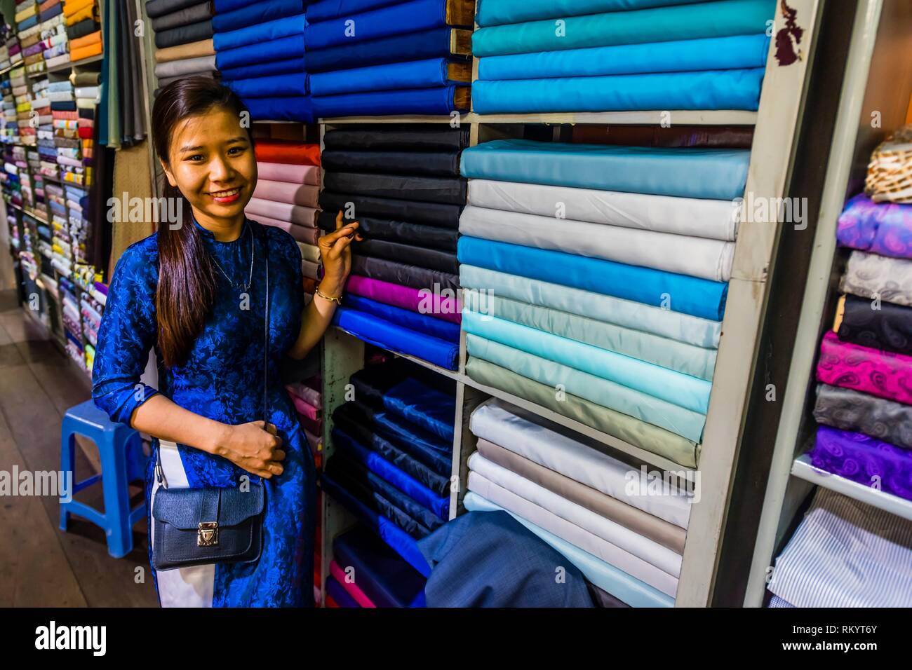 Choosing fabric for the inside of suit jacket, Yaly Couture, the most prestigious bespoke tailor and shoemaker in Hoi An, Vietnam. - Stock Image