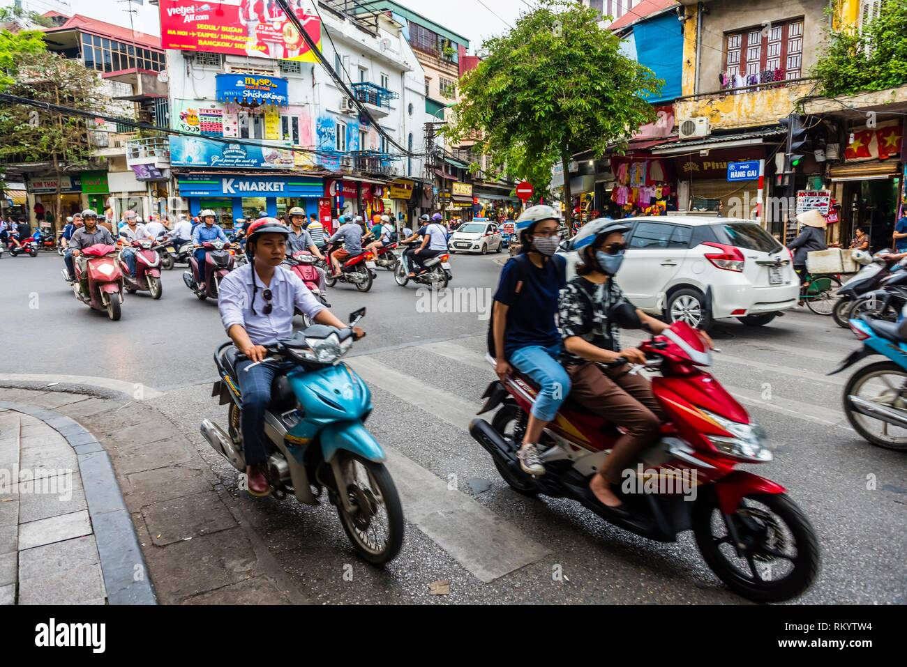 Two wheeled traffic in Hanoi, northern Vietnam. - Stock Image