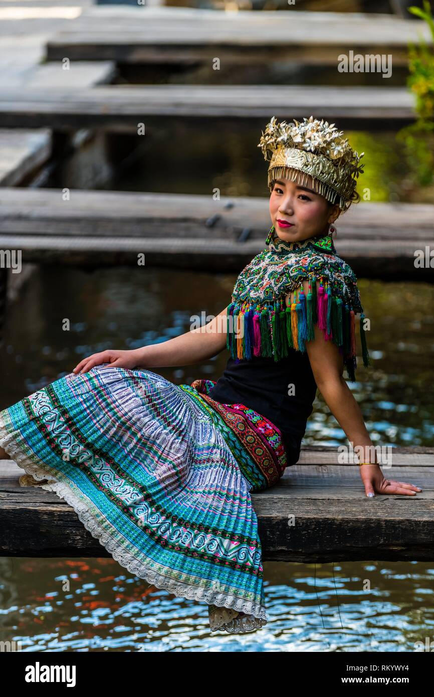 A woman wearing costume of the Miao Minority, Xinhua Street in the Old Town (called Dayan) of Lijiang, Yunnan Province, China. The Old Town is a - Stock Image