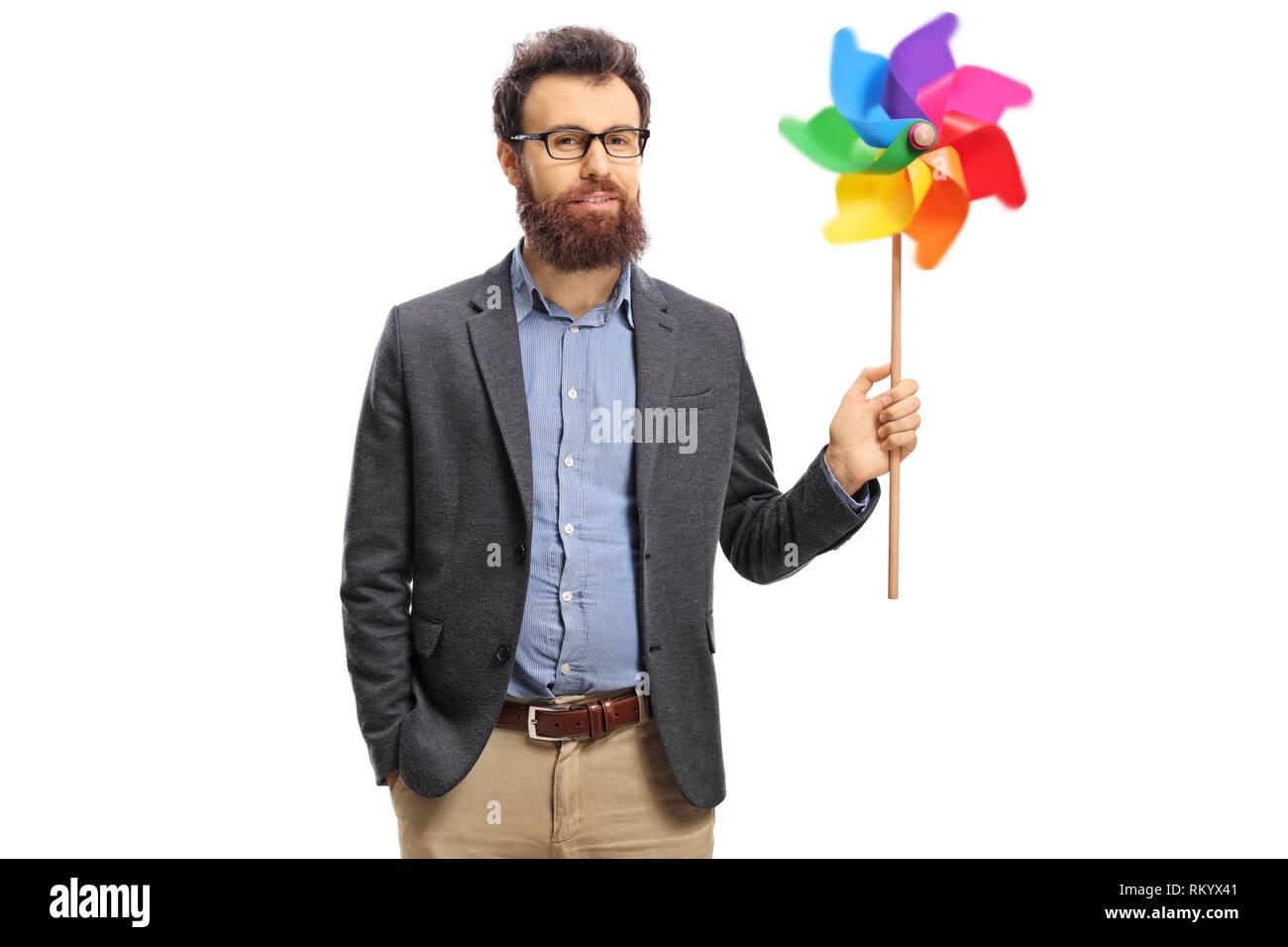 Bearded man holding a spinning pinwheel isolated on white background Stock Photo
