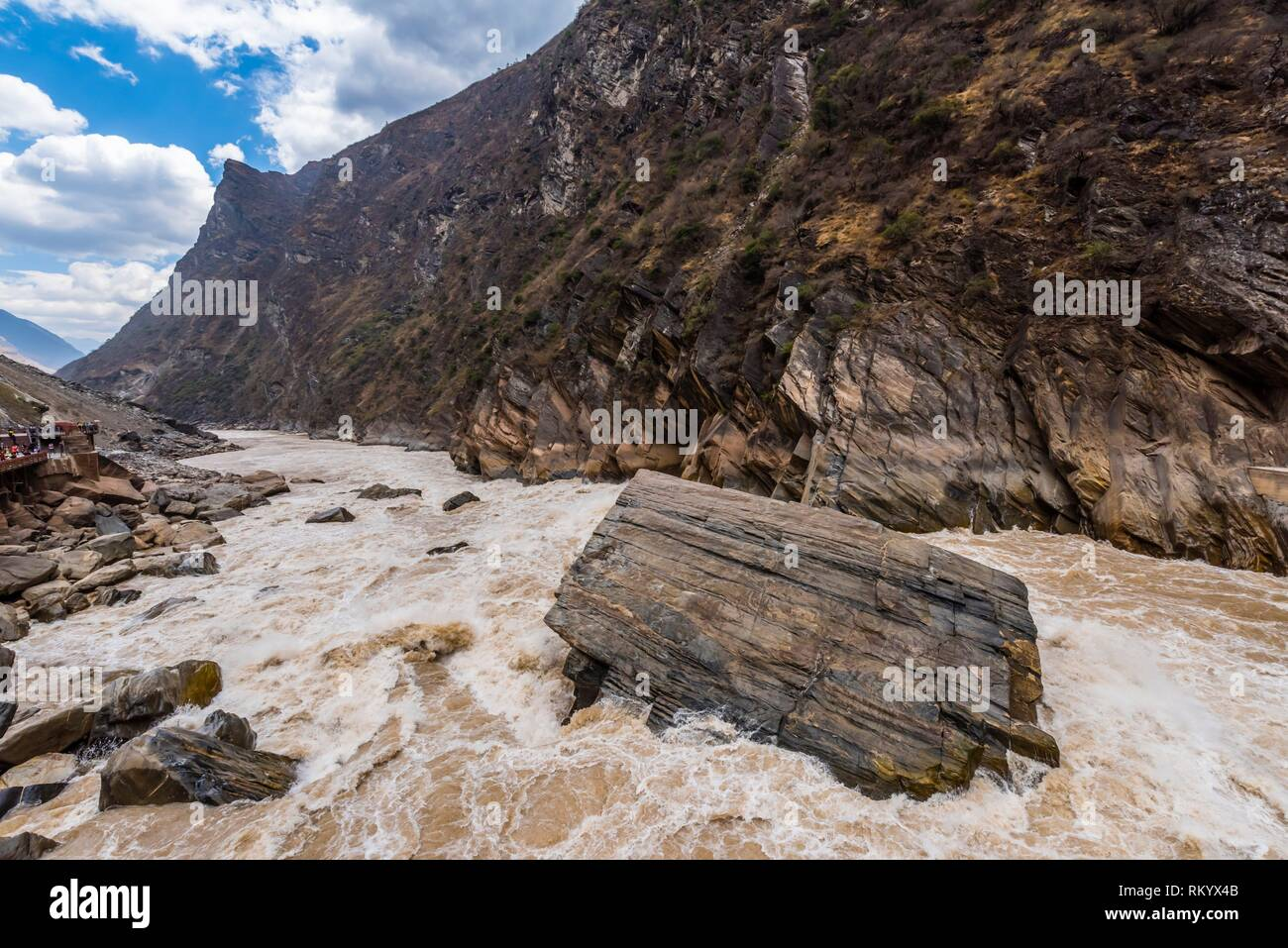 The Tiger Leaping Gorge is a canyon on the Jinsha River (a primary tributary of the upper Yangtze River). 60 kilometers north of Lijiang, it is on Stock Photo