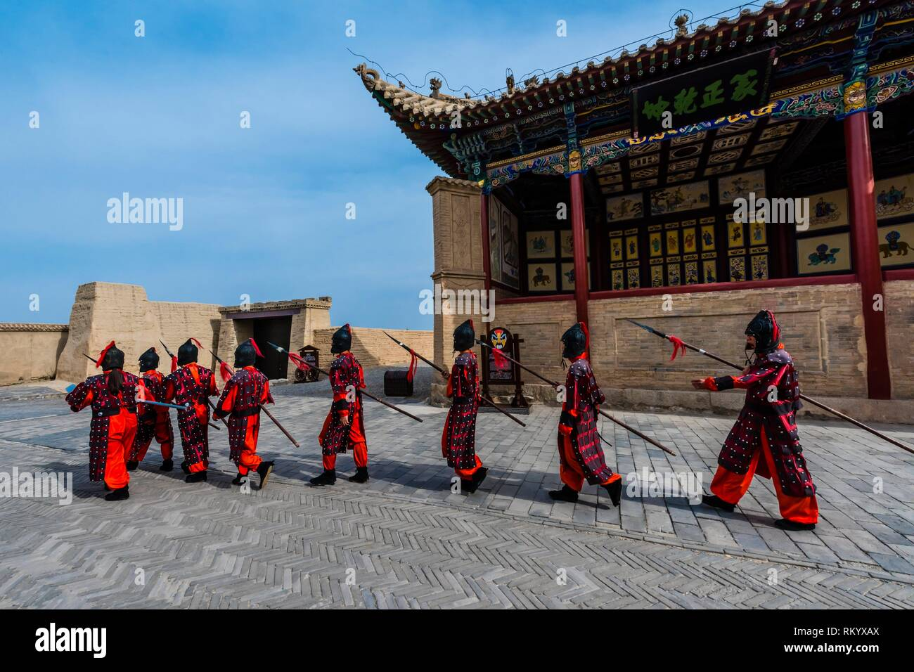 A mock army like one that would have once occupied the fort. Jiayuguan Fort is the western end of the Great Wall built in the Ming Dynasty (1368 - - Stock Image