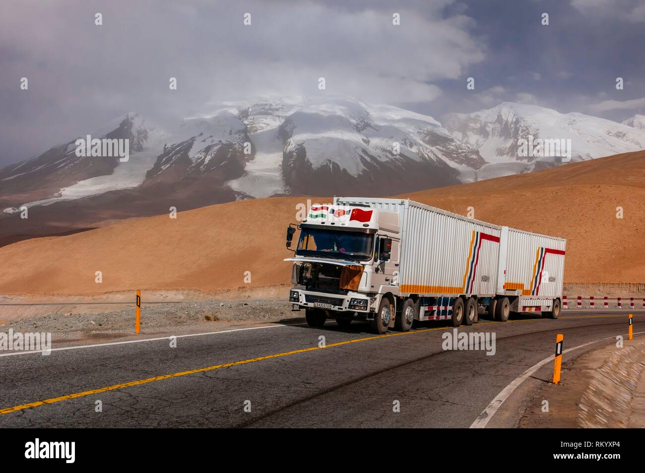 13,451 foot Suvax Pass along the Karakoram Highway passing through the Pamir Mountains in Xinjiang China. It is the highest paved international road - Stock Image