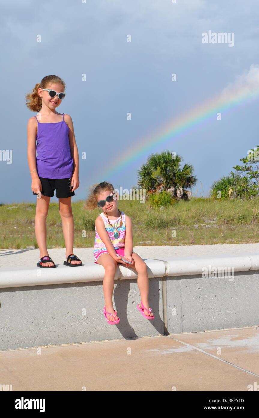 Girls with Rainbow - Stock Image