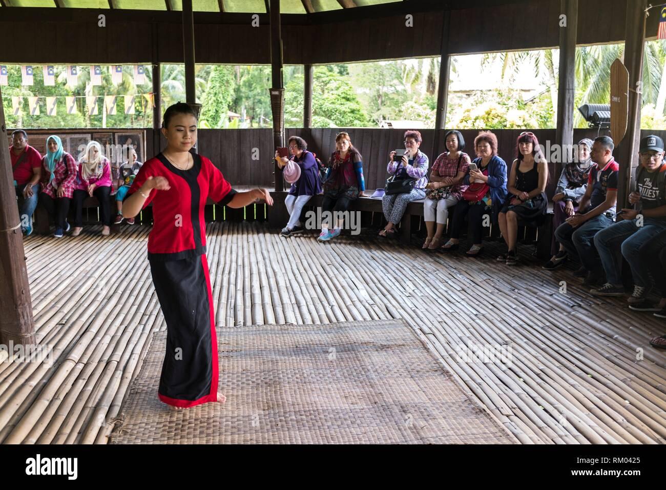 Bidayuh welcoming dance at Sarawak Cultural Village also named as Sarawak Living Museum, Damai, Malaysia - Stock Image