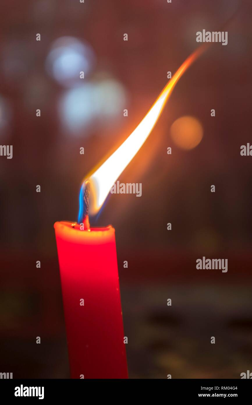 Flame of a candle in the darkness - Stock Image