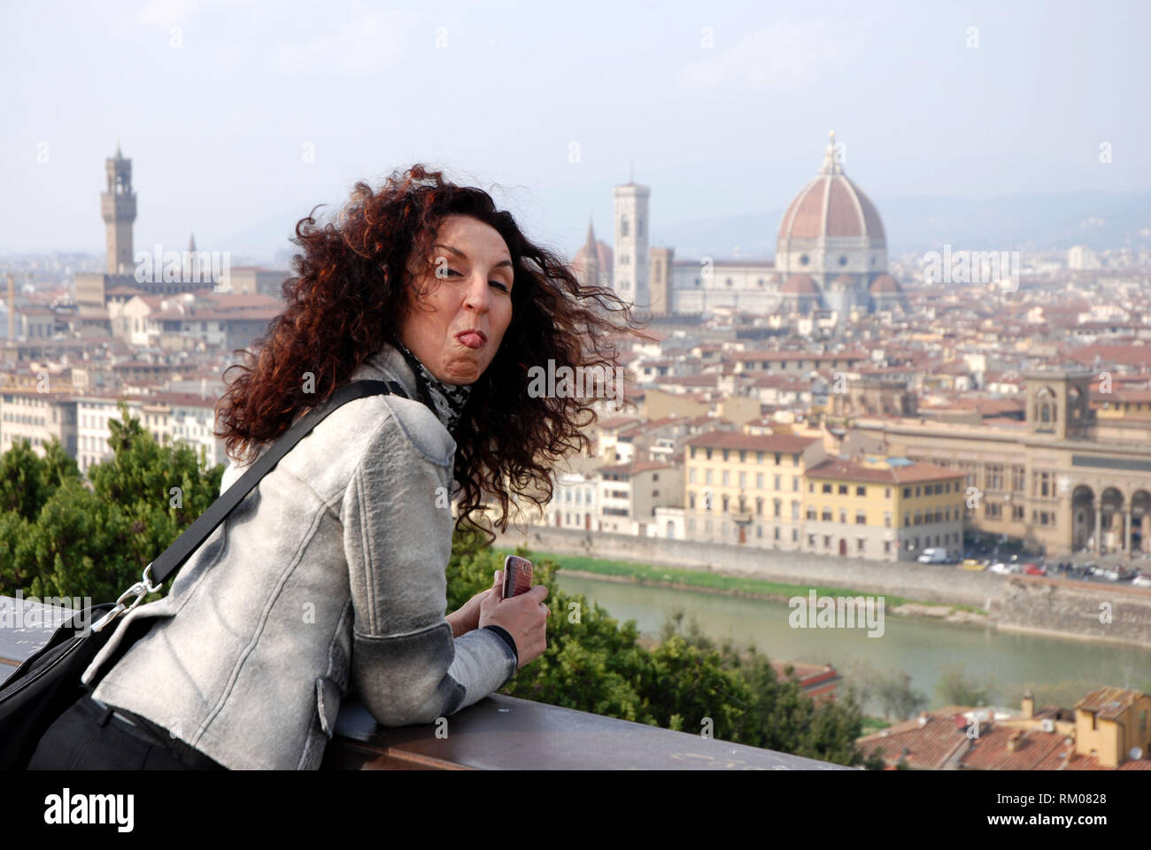 tourist admires view of florence city from piazzale michelangelo terrace tuscany italy 2018 - Stock Image