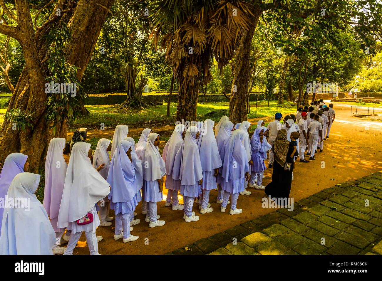 Muslim school girls, Sacred Quadrangle, Ruins of ancient city, Polonnaruwa, Sri Lanka. - Stock Image