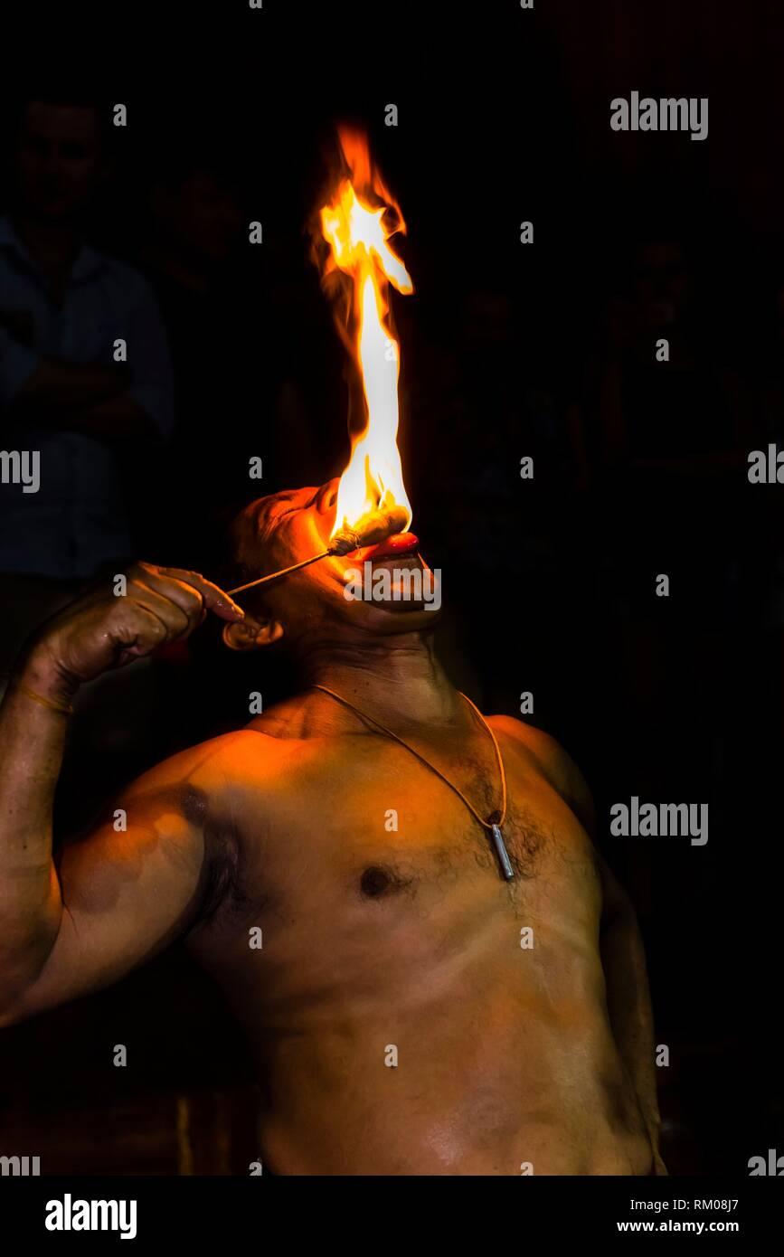 Fire eating, ''Dances of Sri Lanka'' cultural performance, Kandy, Central Province, Sri Lanka. - Stock Image