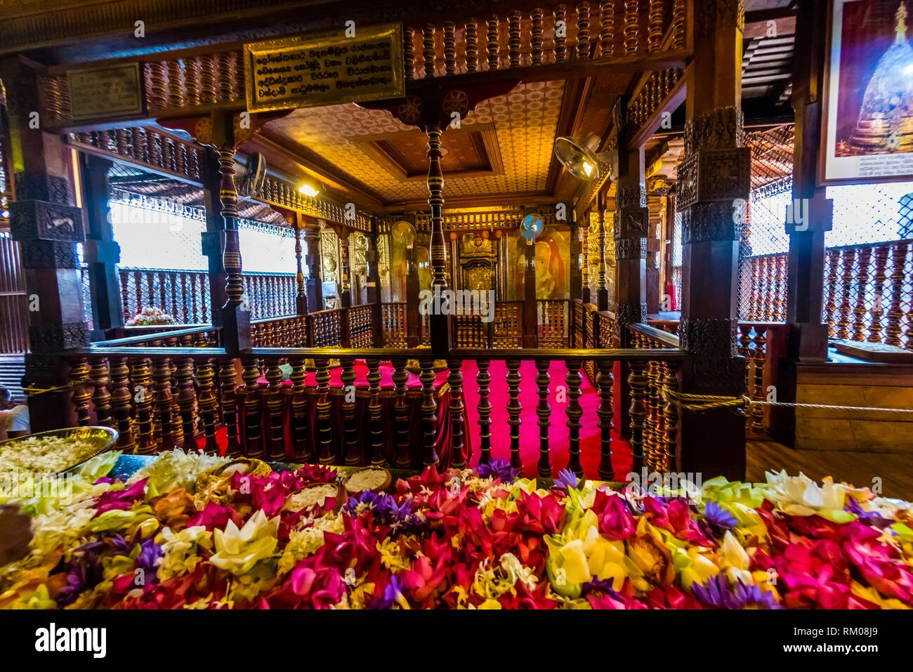 Prayer offerings outside the chamber holding the Sacred Tooth, Temple of the Sacred Tooth Relic (Sri Dalada Maligawa), Kandy, Central Province, Sri - Stock Image