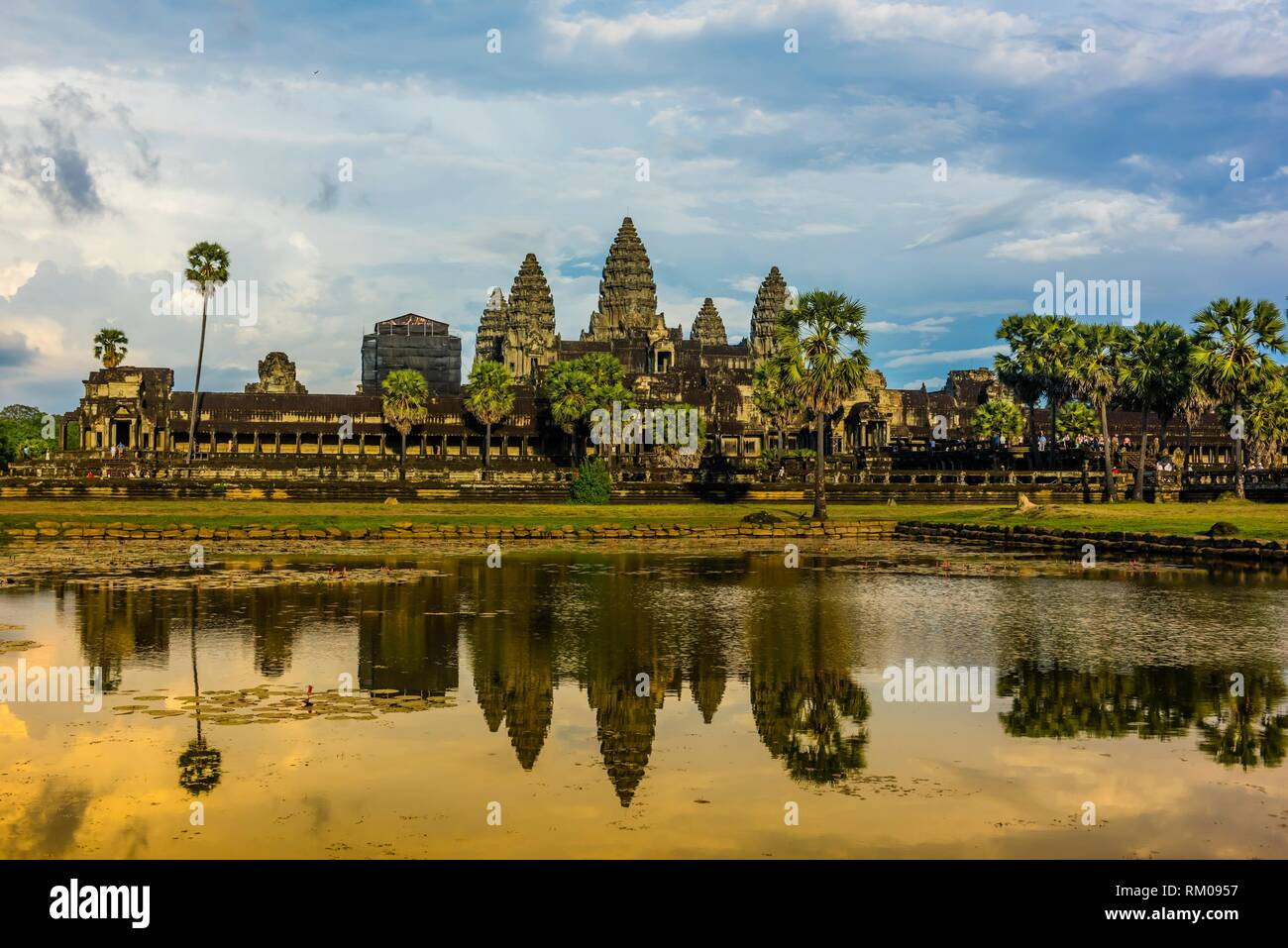 View of Angkor Wat with pond. It is the largest religious monument in the world. It's name means City which is a temple; Cambodia. Stock Photo