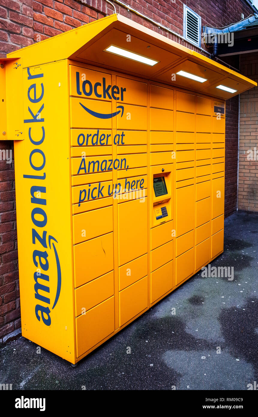 Amazon Locker - Amazon storage locker allowing customers to pick up goods ordered from a secure location using a transmitted access code. - Stock Image