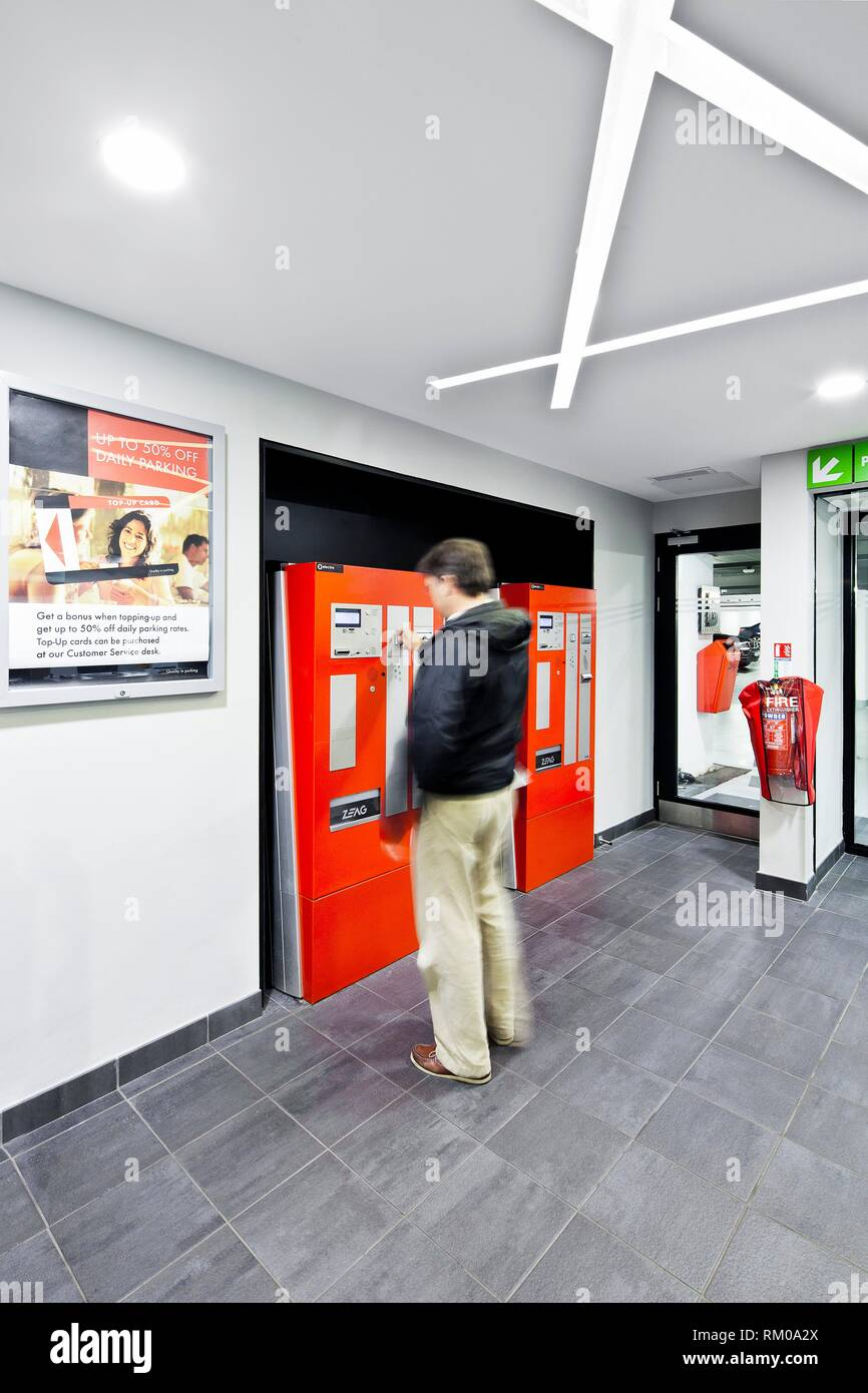 Customer using a car park ticketing machine, located in a car park, Dublin, Co. Dublin Ireland. - Stock Image