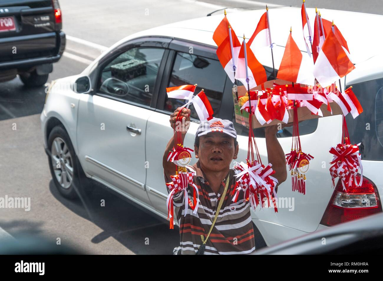 Street vendor selling national flags in Jakarta, Indonesia - Stock Image