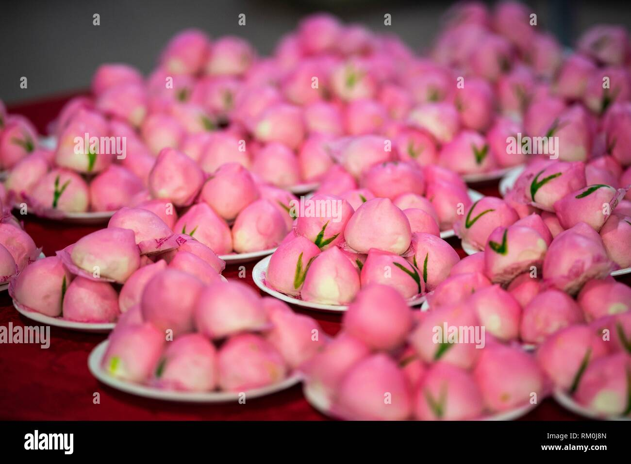 Steamed Longevity buns were served during the Sarawak Chai´s Clan Women Section 20th anniversary celebration in Kuching, Malaysia - Stock Image