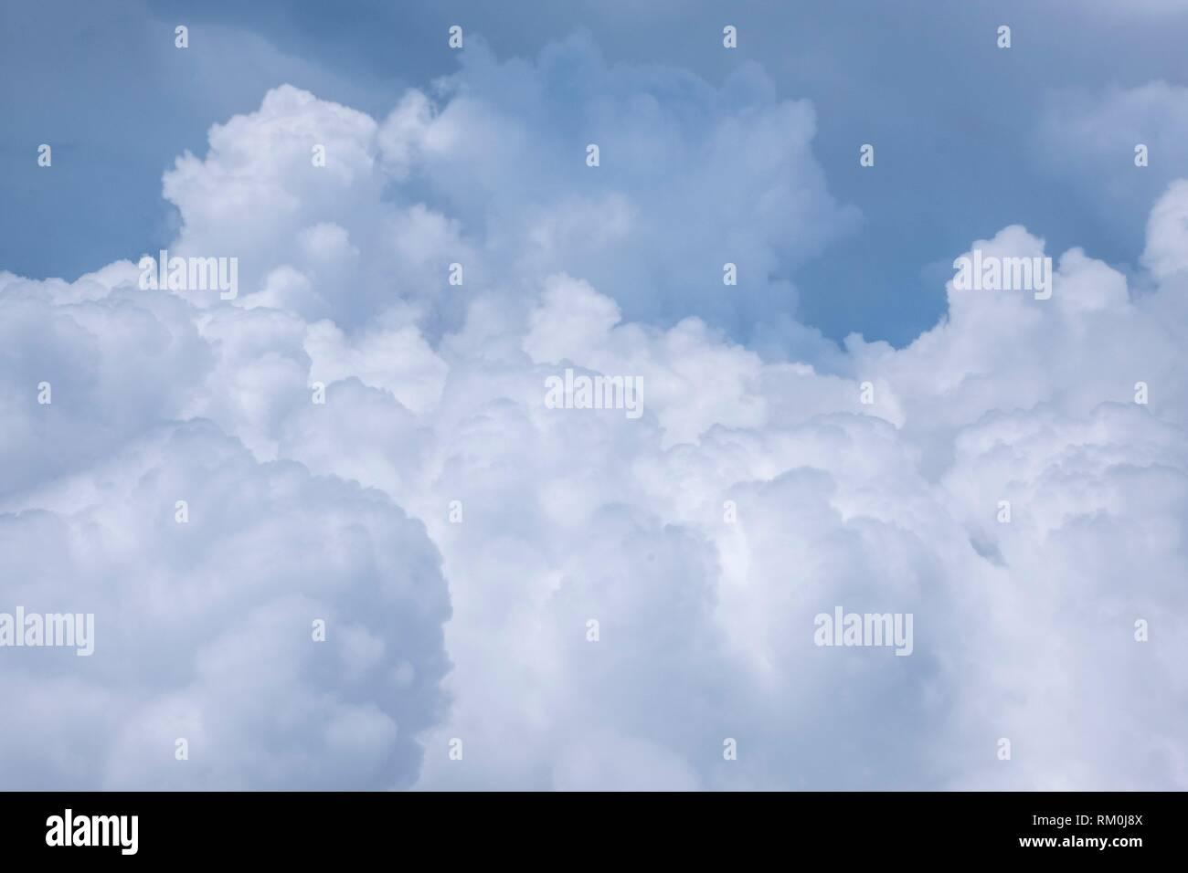 Blue sky with white cloud seen during Limbang-Miri flight, Sarawak, Malaysia - Stock Image