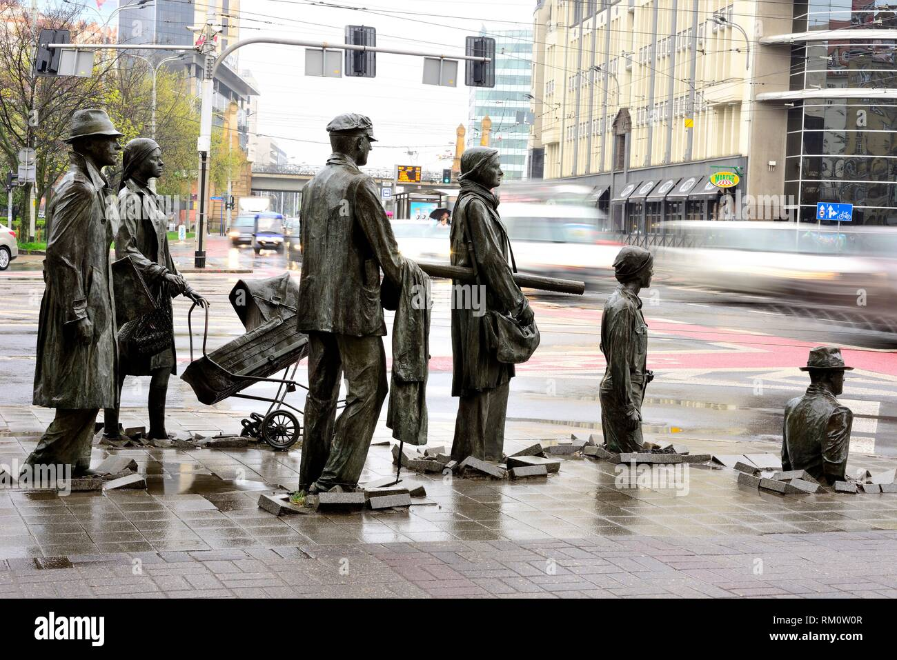 The Anonymous pedestrian, The sculpture presents people who go down, under the pavement and emerge from it, Swidnicka street, Wroclaw ''Breslau'', - Stock Image