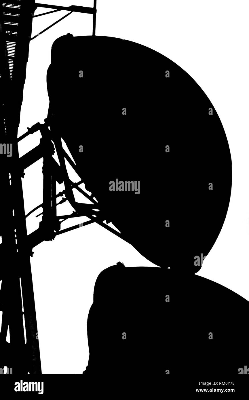 Black and white silhouette of communication antennas and part of a touer - Stock Image