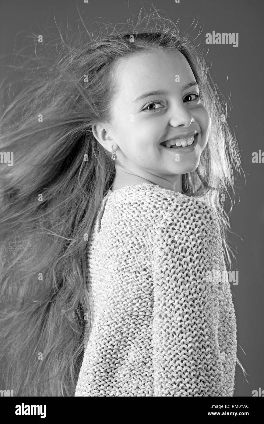 small girl with long hair. childhood of happy kid. beauty. kid hairdresser. Skin and hair care. Fashion portrait of little girl. Hip and stylish - Stock Image