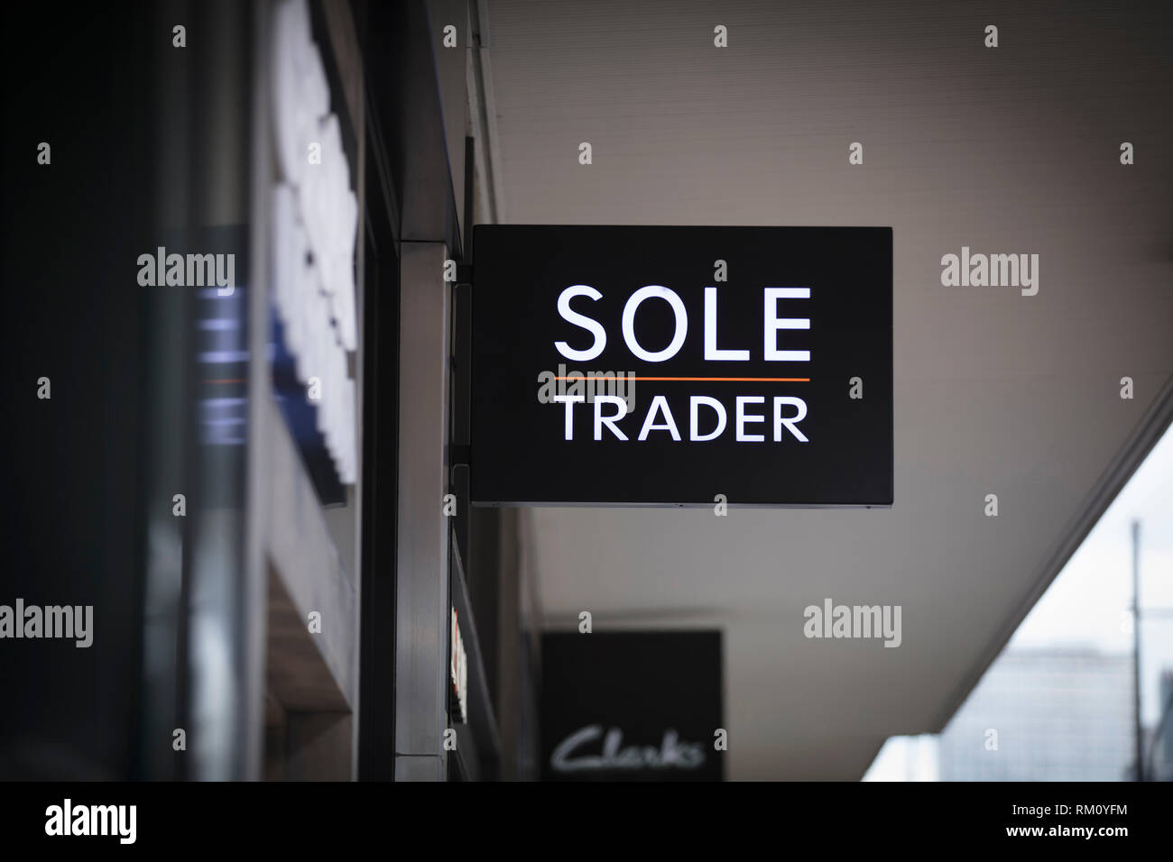 London, Greater London, United Kingdom, 7th February 2018, A sign and logo for sole trader store - Stock Image