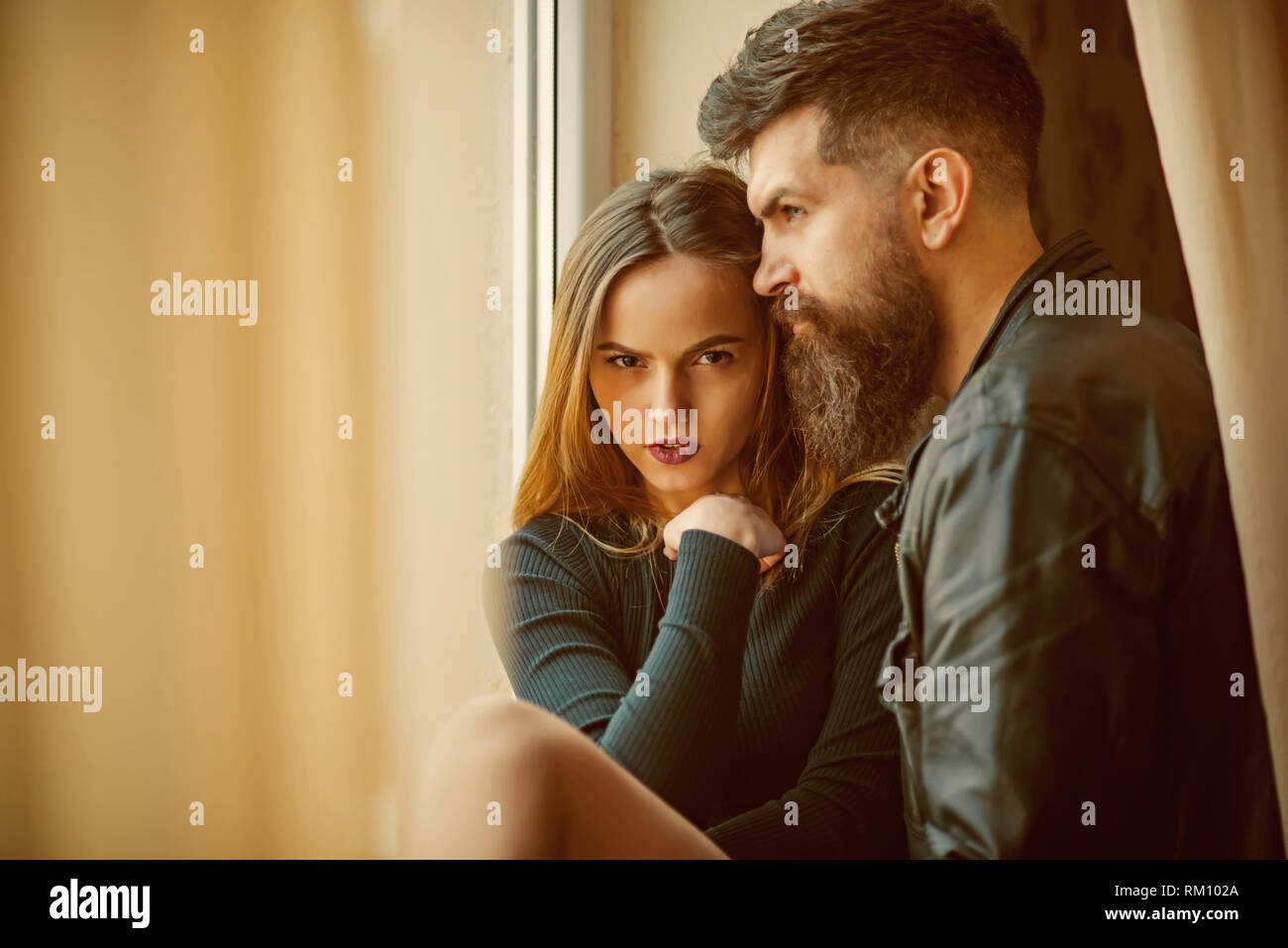 Couple in love spend nice time at home. Couple of man and woman together - Stock Image