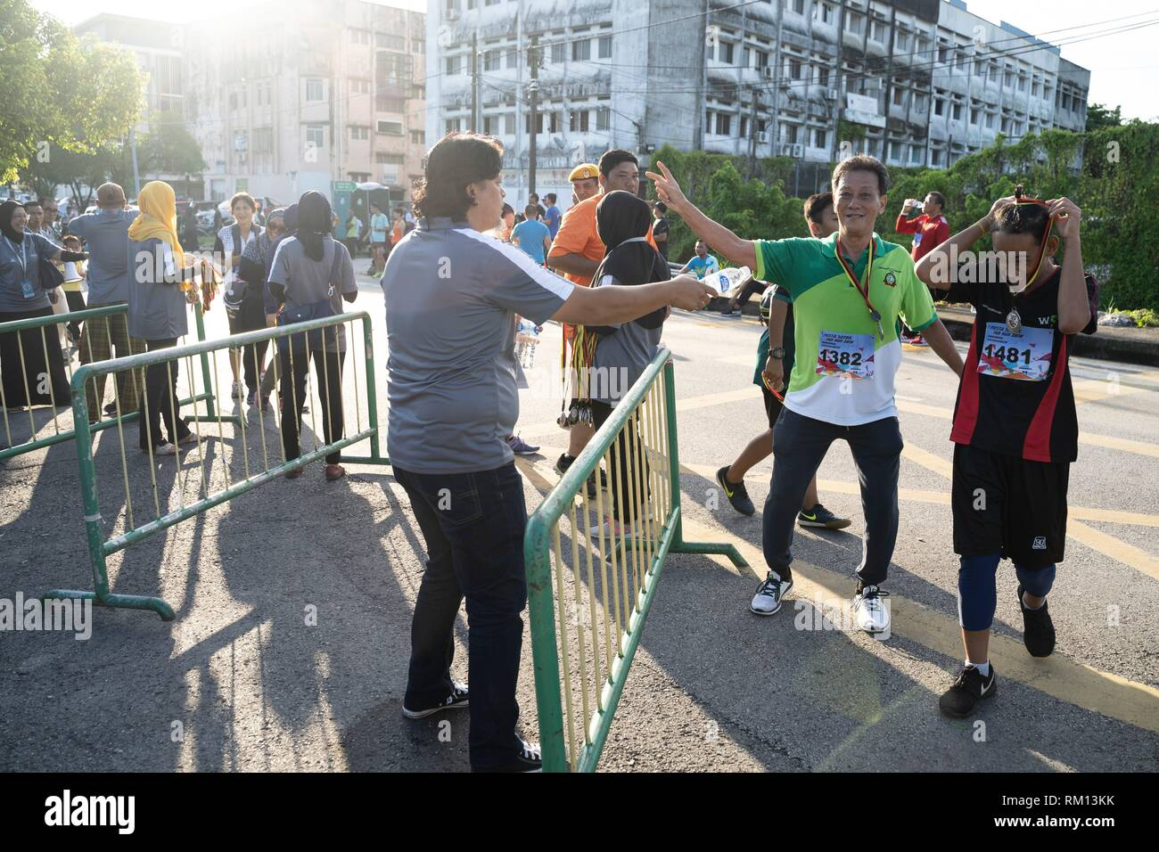 Happy runners at the finish line of the Kuching City North fun run at Kampung Ajibah ABol, Kuching, Sarawak, Malaysia - Stock Image